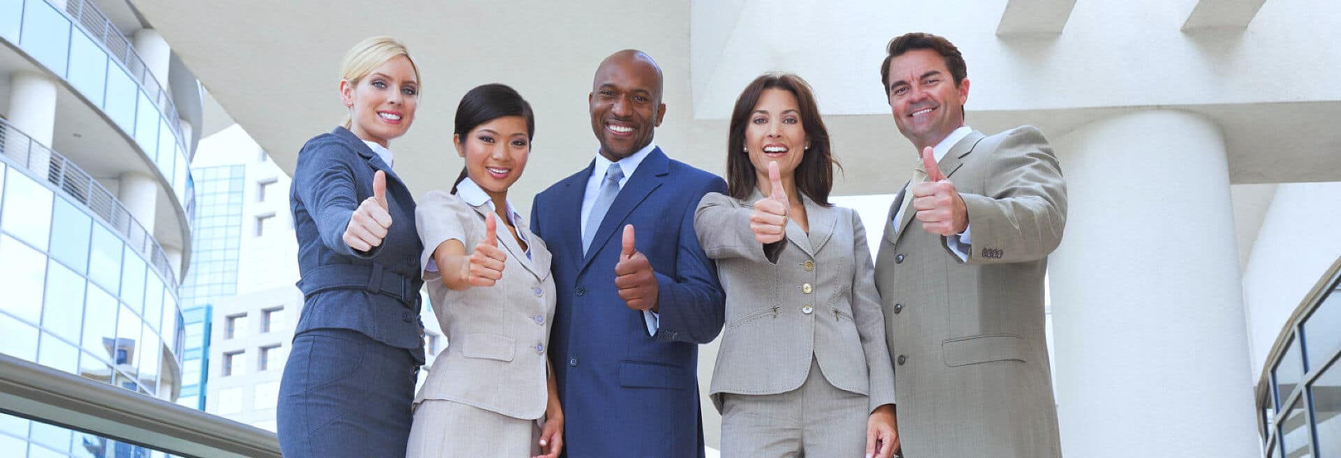 business people raising thumbs